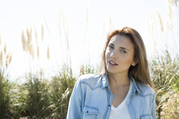 Young woman outdoors in nature, portrait