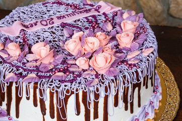 cake with chocolate and cream flowers