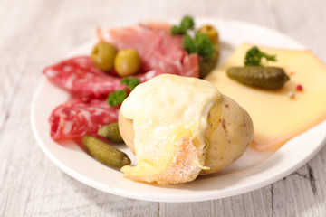 raclette cheese melted with potato and meats