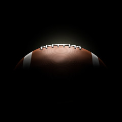 american football ball on black background concept