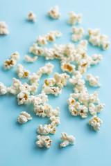 Popcorn on blue background.