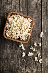 Popcorn on wooden table.