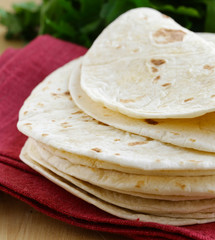 homemade flat cakes tortillas on wooden table