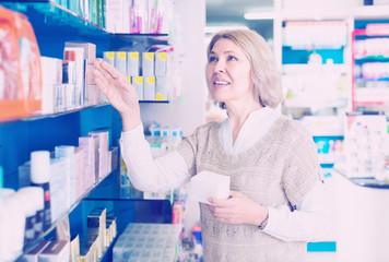 Female customer in pharmacy drugstore  .