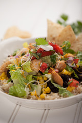 Homemade fresh organic chicken chipotle black bean salad bowl macro shot