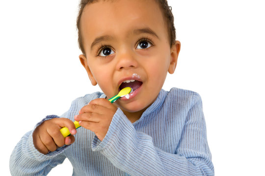 Toddler with tooth brush