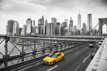 taxi crossing brooklyn bridge