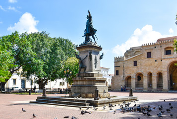Santo Domingo, Dominican Republic. View of Christopher columbus statue and Cathedral in Columbus Park, Colonial Zone.