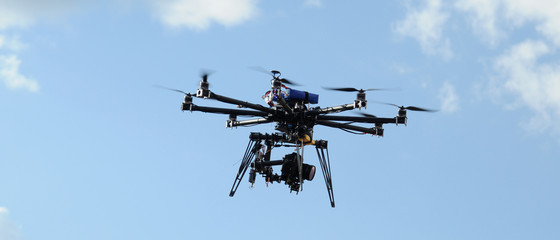octocopter drone with digital camera in flight, used toning of the photo