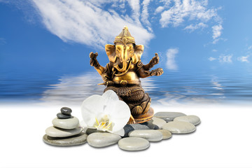 Ganesha or Ganapati,zen stone,white orchid flowers and sky reflected in water