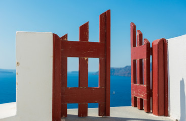 Red door and the boat, Santorini Oia village