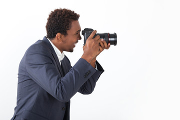 Side view of African photographer