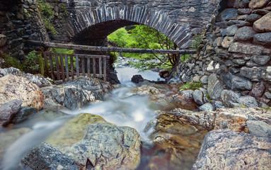 Scenic Stone Bridge over Mountain Creek in Lake District National Park