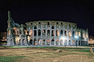 Colosseum in city center of Rome in Italy at twilight