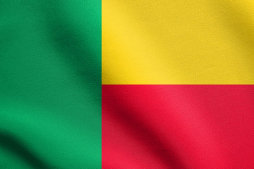 Flag of Benin waving with fabric texture