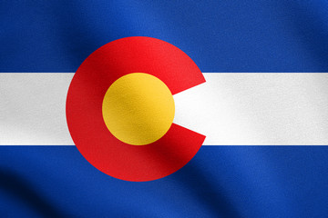 Flag of Colorado waving with fabric texture