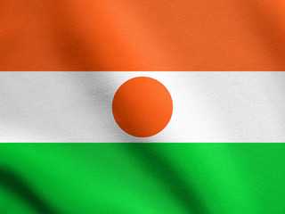 Flag of Niger waving with fabric texture