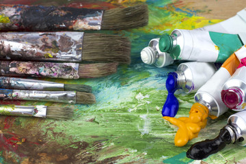 Paint colors and brushes on artist pallette