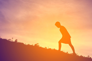 Silhouette a boy running on sunset