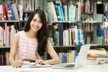 Asian students Reading and researching on the study in the libra