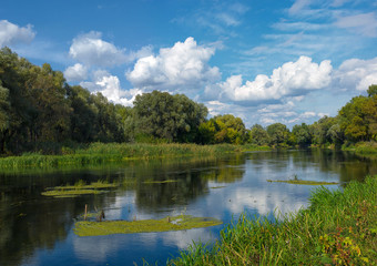 Summer river landscape with clouds