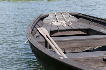 Wooden oars in rowing boat on lake.