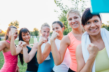 Beautiful sports women take photo after training