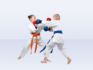 Karate sparring are training athletes in karategi
