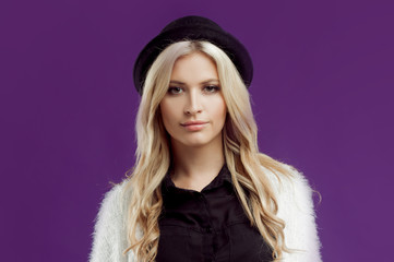 Young beautiful blonde woman in a fashionable hat.