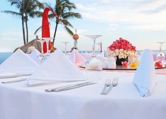 Decorated wedding table at reception beach resort