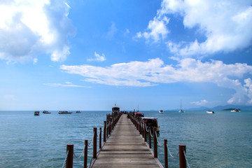Old wood bridge pier and blue sky, Andaman Sea,  thailand
