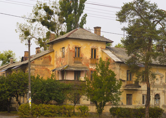 Old Rustic Residential House Among Green Trees