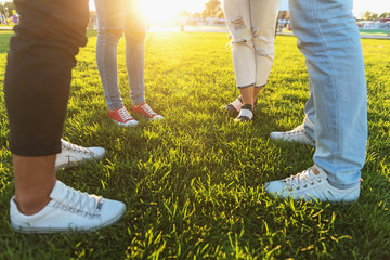 four friends in sneakers outdoors