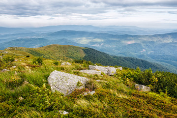 huge stones in valley on top of mountain range