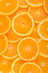 citrus background. juicy slices of  orange cover the entire surface.