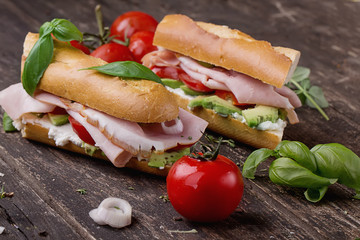 Sandwiches on rustic wooden Board