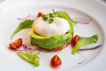 Healthy avocado poached eggs breakfast set