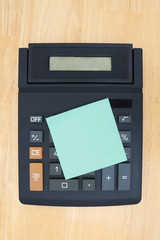 Black calculator with a display on a desk