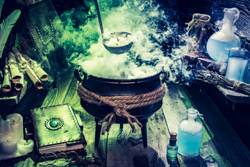 Mysterious witch pot with blue potions and books for Halloween