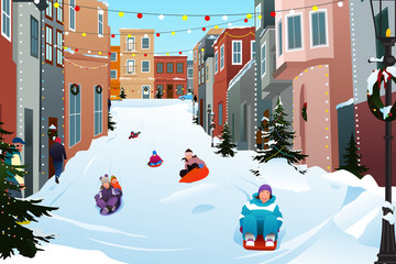Kids Sledding on a Snowy Street During Winter Season