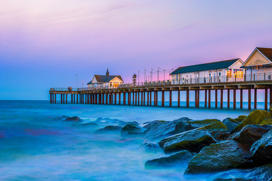 Southwold Pier, a popular English seaside destination in Suffolk, at sunset