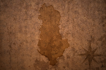 albania map on vintage crack paper background