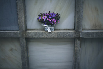 grave in the cemetery with flower bouquet