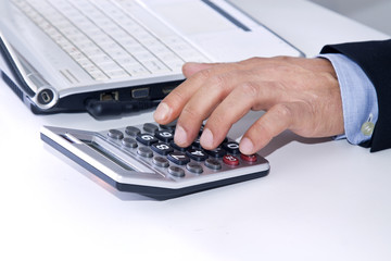 hands of businessman in the office with computer and calculator