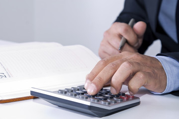 hands of businessman in the office with calculator
