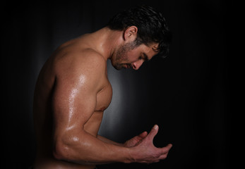 Strong man In Studio on black