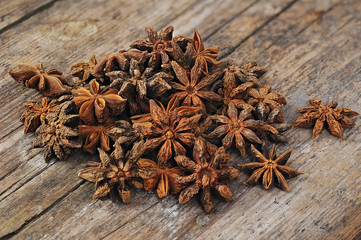Star anise on old wooden table