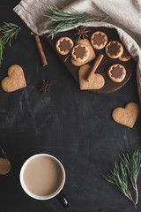 Christmas composition. Cup of coffee, christmas gingerbread, pin