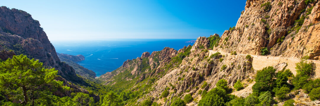 Stunning scenery of D81 road through the Calanches de Piana on the west coast of Corsica, France, Europe.