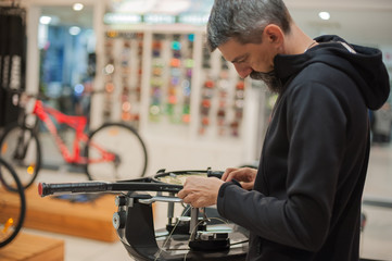 Stringing Machine. Tennis stringer doing racket stringing in his workshop